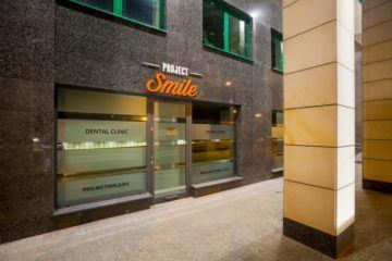 Project Smile Dental Clinic - Green Office Building Front Entrance
